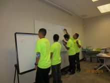 Students using a whiteboard.